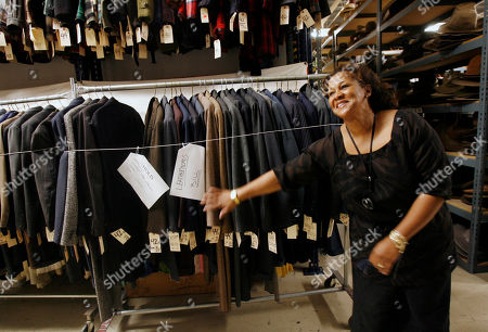 Costume designer Sharen Davis looks through clothes at The Motion Picture Costume Co., in Burbank, Calif. The Academy of Motion Picture Arts and Sciences announced its newly elected board of governors on . The list includes six first-time representatives: director Steven Spielberg, actress Laura Dern, costume designer Davis, documentarian Roger Ross Williams, composer Laura Karpman and sound engineer Kevin Collier