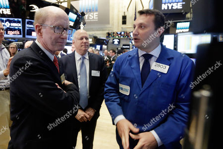 John Brock, Jeffrey Sprecher, Vincent Surace Coca-Cola European Partners CEO John Brock, left, and Jeffrey Sprecher, center, Chairman and CEO of Intercontinental Exchange and Chairman of the New York Stock Exchange, talk with specialist Vincent Surace, on the floor of the New York Stock Exchange, before Brock rings the opening bell