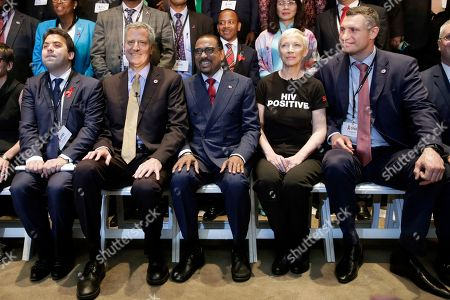 Patrick Klugman, Bill de Blasio, Michel Sidibe, Annie Lennox, Vitali Klitschko Some of the participants in the Global Mayors Meeting on Ending AIDS in Cities pose for a group photo, at the main branch of the New York Public Forum, . They are, from left: Deputy Paris Mayor Patrick Klugman; New York Mayor Bill de Blasio; Executive Director of UNAIDS Michel Sidibe; singer Annie Lennox: and Kiev Mayor Vitali Klitschko