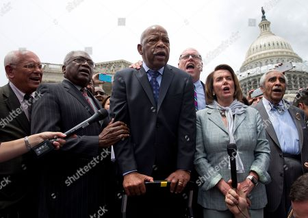 """Paul Tonko, James Clyburn, John Lewis, Joseph Crowley, Charles Rangel From left, Rep. Paul Tonko, D-N.Y., House Assistant Minority Leader James Clyburn of S.C., Rep. John Lewis, D-Ga., Rep. Joseph Crowley, D-N.Y., House Minority Leader Nancy Pelosi of Calif. and Rep. Charles Rangel, D-N.Y., sing """"We Shall Overcome"""" on Capitol Hill in Washington, after House Democrats ended their sit-in protest"""