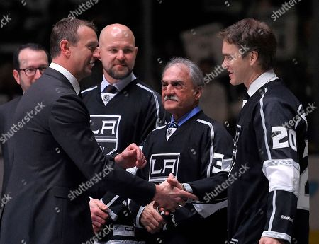 Rob Blake, Luc Robitaille, Mattias Norstrom, Rogie Vachon Former Los Angeles Kings player Rob Blake, left, shakes hands with former teammate Luc Robitaille, right, as Mattias Norstrom, second from left, and Rogie Vachon watch during a ceremony to retire his jersey, prior to an NHL hockey game between the Kings and the Anaheim Ducks, in Los Angeles. Vachon was elected to the Hockey Hall of Fame