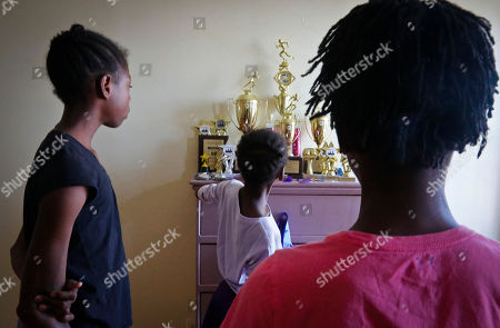 """Tai Sheppard, Rainn Sheppard, Brooke Sheppard The Sheppard sisters Tai, 11, left, Brooke, 8, center, and Rainn, 10, show their winning track trophies and medals, during an interview at their Brooklyn shelter apartment, in New York. The sisters have only been running track and field for a year and a half, but already rank at the top of their field. """"They're some of the best athletes in the country in their age groups,"""" said their coach Jean Bell of the Jeuness Track Club. """"For the upcoming junior Olympics in Houston we expect for them to bring home many, many medals and that's not an easy feat"""