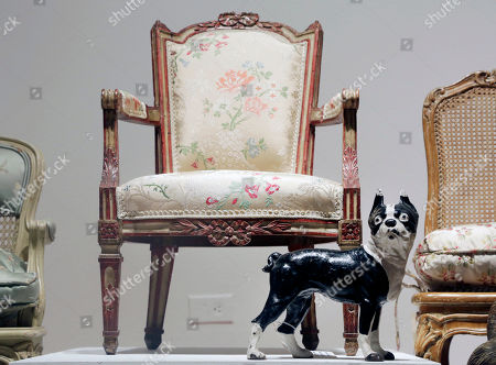 A French child's chair and model of a dog, owned by the late comedian Joan Rivers, are displayed at Christie's, in New York. The Private Collection of Joan Rivers has more than 200 lots to be auctioned in a live sale at Christie's on June 22 and about 80 more offered online at Christies.com, starting Thursday through June 23