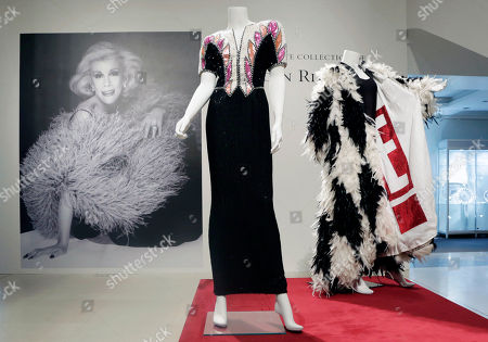 A black, cream and pink beaded evening gown, center, owned by the late comedian Joan Rivers, is displayed at Christie's, in New York. The Private Collection of Joan Rivers has more than 200 lots to be auctioned in a live sale at Christie's on June 22 and about 80 more offered online at Christies.com, starting Thursday through June 23