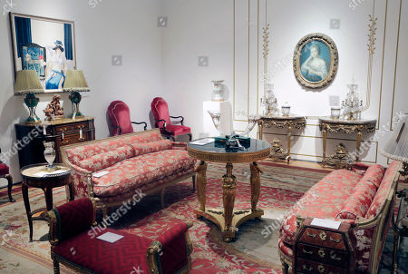 """Living room items owned by the late comedian Joan Rivers are displayed at Christie's, in New York. She was many things - the queen of QVC, a brash and brassy voice on """"Fashion Police,"""" but she had a keen eye as a collector, of period furniture, Faberge objets d'art and fine furnishings she embraced from her penthouse on East 62nd Street"""