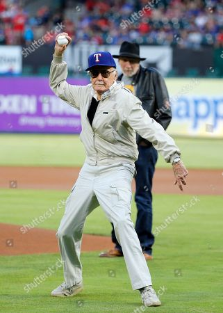 Stan Lee Stan Lee of Marvel Comics fame winds up to throw out the ceremonial first pitch as Frank Miller, rear, a writer, director and actor watches, before a baseball game between the Seattle Mariners and Texas Rangers, in Arlington, Texas