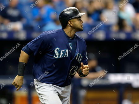 Nelson Cruz Seattle Mariners' Nelson Cruz follows the flight of his two-run home run off Tampa Bay Rays' Drew Smyly during the fourth inning of a baseball game, in St. Petersburg, Fla