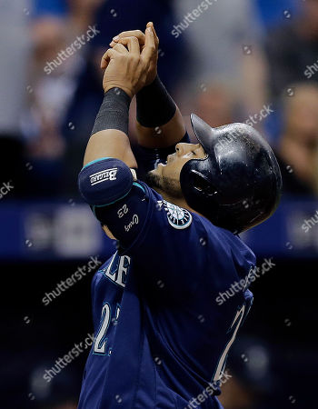 Nelson Cruz Seattle Mariners' Nelson Cruz reacts as he crosses home plate after his two-run home run off Tampa Bay Rays starting pitcher Drew Smyly during the fourth inning of a baseball game, in St. Petersburg, Fla