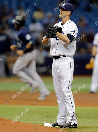 Nelson Cruz, Drew Smyly Tampa Bay Rays starting pitcher Drew Smyly reacts as Seattle Mariners' Nelson Cruz runs around the bases after his two-run home run during the fourth inning of a baseball game, in St. Petersburg, Fla