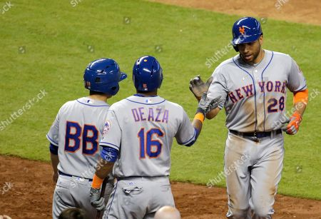 James Loney, Alejandro De Aza New York Mets' James Loney (28) is met by Jose Fernandez (16) after scoring on a single hit by Michael Conforto during the eighth inning of a baseball game against the Miami Marlins, in Miami