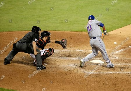 Michael Conforto, J.T. Realmuto New York Mets' Michael Conforto (30) hits a RBI-single to score James Loney as Miami Marlins catcher J.T. Realmuto looks on during the eighth inning of a baseball game against the Miami Marlins, in Miami