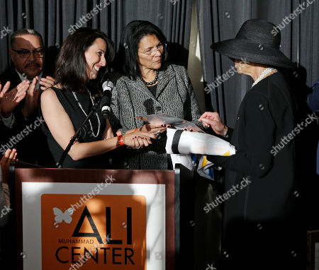 Janet Evans, Anita DeFrantz, Lonnie Ali Olympic gold medal-winning swimmer Janet Evans, left, and Anita DeFrantz of the International Olympic Committee, center, present an Olympic flag to Lonnie Ali, right, at the Muhammad Ali Center, in Louisville, Ky