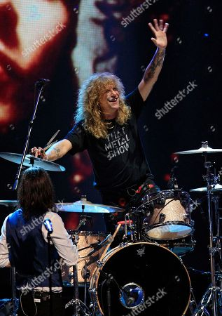 Stock Image of Steven Adler Drummer Steven Adler waves during a performance after Guns N' Roses' induction into the Rock and Roll Hall of Fame in Cleveland. Adler took the stage in Cincinnati, to mark his first performance with the band fronted by Axl Rose in more than a quarter century