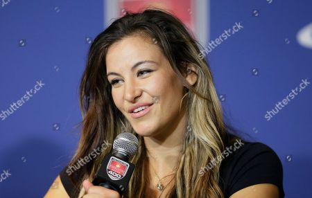 Miesha Tate Mixed martial artist Miesha Tate, who competes in the Ultimate Fighting Championship, responds to a question during a news conference before the NASCAR Sprint Cup series auto race at Michigan International Speedway, in Brooklyn, Mich. Tate, who is the current UFC Women's Bantamweight Champion, is the Grand Marshal of Sunday's race