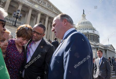 Bonnie Watson Coleman, Debbie Dingell, Gwen Graham, Marc Veasey, Dan Kildee From left, Rep. Bonnie Watson Coleman, D-N.J., Rep. Debbie Dingell, D-Mich., Rep. Gwen Graham, D-Fla., Rep. Marc Veasey, D-Texas, and Rep. Dan Kildee, D-Mich., comfort each other as members of Congress join the LGBT Congressional Staff Association and the Congressional Muslim Staff Association for a vigil and moment of silence on the steps of the Capitol to stand in solidarity with the Orlando community and to remember the victims of Sunday's shooting at an LGBT night club, in Washington