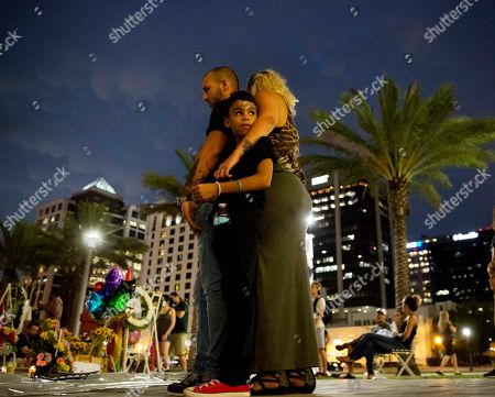 Jennifer Johnson, Jeansem Sambolin, Tyrone Clarke Jennifer Johnson, right, leans on her boyfriend Jeansem Sambolin while standing with her son Tyrone Clarke, 8, as they visit a makeshift memorial for the victims of the mass shooting at the Pulse Orlando nightclub, in Orlando, Fla. Franky Jimmy Dejesus Velazquez was one of those killed and had worked with Johnson