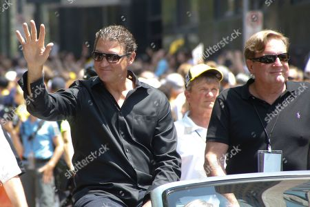 Mario Lemieux, Ron Burkle Pittsburgh Penguins owners Mario Lemieux, left, and Ron Burkle acknowledge fans as they ride along the victory parade route in Pittsburgh, Pa., . The Penguins defeated the San Jose Sharks on Sunday to win the NHL hockey championship