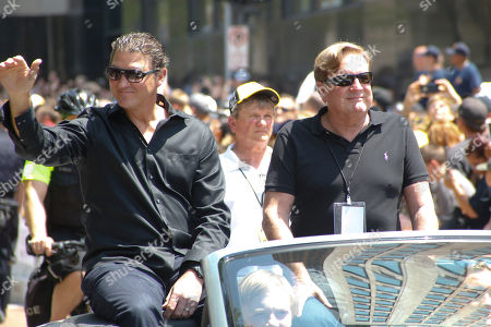 Mario Lemieux, Ron Burkle Pittsburgh Penguins owners Mario Lemieux, left, and Ron Burkle acknoweledge fans as they ride along the victory parade route in Pittsburgh, Pa., . The Penguins defeated the San Jose Sharks on Sunday to win the NHL hockey championship