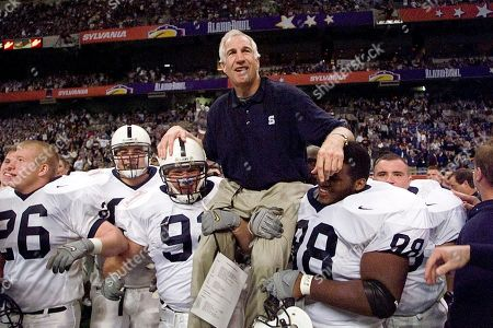 Stock Photo of Jerry Sandusky FILE - In this Dec. 28, 1999 photo shows Penn State defensive coordinator Jerry Sandusky being carried by players Rick Bolinsky (92), center left, and Jason Wallace (88) after they defeated Texas A&M in the Alamo Bowl, in San Antonio, Tex. Newly released court documents provided new details, on allegations that Penn State Coach Joe Paterno was told in 1976 about a sex abuse accusation against his assistant, Jerry Sandusky, and that some of Paterno's assistants witnessed improper contact between Sandusky and children in the 1980s. Sandusky, who was arrested in 2011, is serving 30 to 60 years in prison on a 45-count child molestation conviction