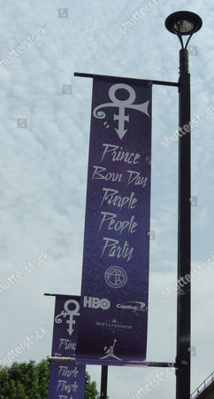 """Stock Image of A banner promoting the event is displayed on a lamp post near the location of the """"Prince Born Day Purple People Party""""? in New York, . The multi-talented singer, musician and songwriter was found dead in his Minneapolis, Minn. home on April 21. Prince Rogers Nelson would have been 58 on June 7"""