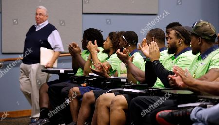 Gary Wright Seattle Seahawks rookies applaud as former team executive Gary Wright steps up to speak to them at the football team's training camp, in Renton, Wash. The team is holding a rookie symposium for the new players to give them information about the NFL