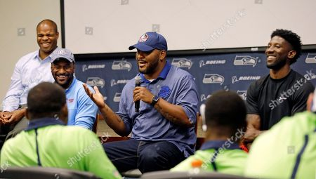 Walter Jones, Bruce Fisher, Jordan Babineaux, Marcus Trufant Former Seattle Seahawks' Walter Jones, center, address rookies during a panel discussion with Bruce Fisher, left, Jordan Babineaux and Marcus Trufant, right, at the football team's training camp, in Renton, Wash. The team is holding a rookie symposium for the new players to give them information about the NFL
