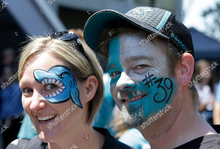 San Jose Sharks fans Rebecca Morris, left, and Christopher Simon pose for photos outside of SAP Center at San Jose before Game 6 of the NHL hockey Stanley Cup Final series between the Sharks and the Pittsburgh Penguins in San Jose, Calif