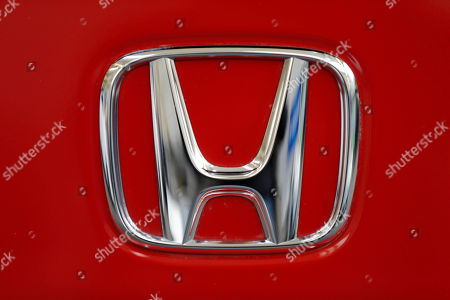 """A Honda logo on the trunk of a Honda automobile at the Pittsburgh Auto Show, in Pittsburgh. The National Highway Traffic Safety Administration said, it is urging owners of 313,000 older Hondas and Acuras to stop driving them and get them repaired after new tests found that their Takata air bag inflators are extremely dangerous. The agency's urgent advisory covers 2001 and 2002 Honda Civics and Accords, the 2002 and 2003 Acura TL, the 2002 Honda Odyssey and CR-V, and the 2003 Acura CL and Honda Pilot, NHTSA said. """"These vehicles are unsafe and need to be repaired immediately,"""" Transportation Secretary Anthony Foxx said in a statement. """"Folks should not drive these vehicles unless they are going straight to a dealer to have them repaired"""