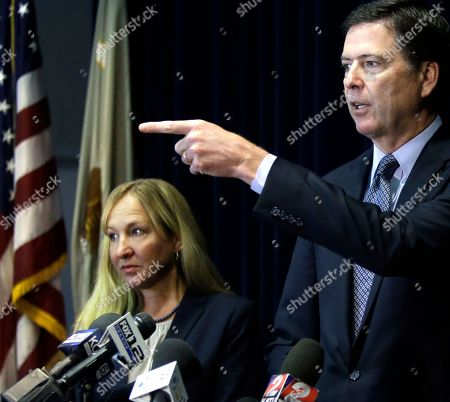 James B. Comey, Amanda Marshall FBI Director James B. Comey, right, gestures as U.S. Attorney Amanda Marshall stands at left during a news conference in Portland, Ore. The federal prosecutor, whose accusation of sexual harassment led Marshall to resign, told investigators he reported her behavior because it was interfering with his ability to eat, sleep and work, and he worried about losing his job. New details of the affair and its aftermath are included in the report obtained, in a Freedom of Information Act request