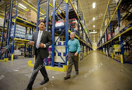 Stock Image of Salvador D. Petilos, Gene Davis Salvador D. Petilos, left, with the Department of Alcoholic Beverage Control, walks with State Sen. Gene Davis, D-Salt Lake, during a tour of the Department of Alcoholic Beverage Control warehouse, in Salt Lake City. Utah lawmakers tour ed a state liquor store and warehouse as critics say Utah's alcohol control agency needs more money and stores to meet the demand from residents