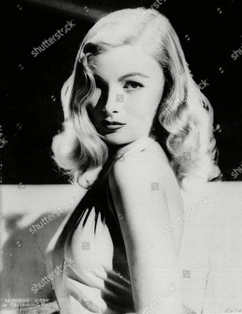 """VERONICA LAKE Veronica Lake is shown when she was the """"peek-a-boo look"""" movie star in the 1940s. In March 1962, she lived in a New York hotel and worked for tips and her meals as a waitress and part-time hostess in the hotel's cocktail lounge"""