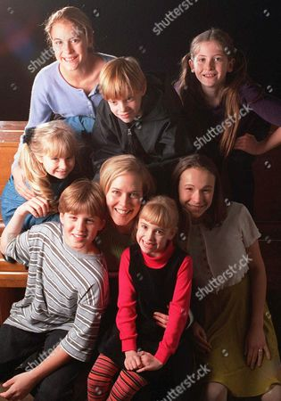 """LUKER Rebecca Luker, star of the Broadway revival of the musical """"The Sound of Music,"""" poses at center with cast members playing the Trapp Family Singers. Clockwise from lower left, are: Ryan Hopkins, Alison Walsh, Ashley Rose, Mathew Ballinger, Natalie Hall, Sara Zelle, and Andrea Bowen"""
