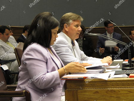 Rep. Chris Broadwater, R-Hammond, right, speaks about his tax bill, sitting with Revenue Secretary Kimberly Robinson during a hearing of the House Ways and Means Committee,, in Baton Rouge, La. Gov. John Bel Edwards called on lawmakers Tuesday to raise millions of dollars more in taxes aimed at closing budget holes and stopping cuts to health care services and education programs. But his package of revenue-raising proposals quickly hit snags in the House Ways and Means Committee