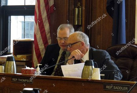 Alaska House Finance Committee co-chairs Mark Neuman, left, and Steve Thompson share a word during a committee hearing, in Juneau, Alaska