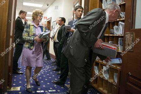 Rep. Gabrielle LeDoux, R-Anchorage, looks on as Alaska Dispatch News reporter Nat Herz interviews Rep. Steve Thompson, R-Fairbanks, right, before a floor legislative session, in Juneau, Alaska