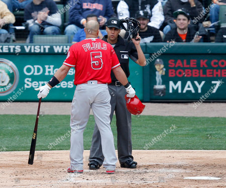 Gabe Morales, Albert Pujols Los Angeles Angels' Albert Pujols (5) talks with home plate umpire Gabe Morales, after Pujols was called out on strikes during the fourth inning of a baseball game, in Chicago