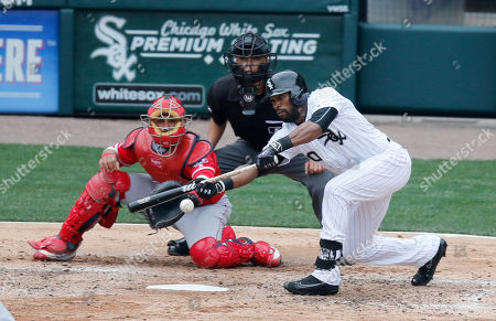 Gabe Morales. Geovany Soto, Austin Jackson Chicago White Sox's Austin Jackson, right, hits a sacrifice bunt as Los Angeles Angels catcher Geovany Soto and umpire Gabe Morales watch during the fifth inning of a baseball game, in Chicago. Jackson was safe at first on a throwing error by starting pitcher Garrett Richards, scoring Alex Avila from second