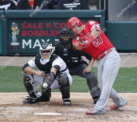 Mike Trout, Alex Avila, Gabe Morales Los Angeles Angels' Mike Trout gets a hit up the middle as Chicago White Sox catcher Alex Avila and umpire Gabe Morales watch during a baseball game, in Chicago