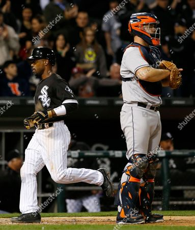 Jimmy Rollins, Evan Gattis Chicago White Sox's Jimmy Rollins, left, scores on a sacrifice fly by Alex Avila as Houston Astros catcher Evan Gattis looks to the field during the seventh inning of a baseball game, in Chicago