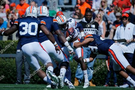 Jason Smith Auburn wide receiver Jason Smith, center, carries the ball in the first half of a spring NCAA college football game, in Auburn, Ala