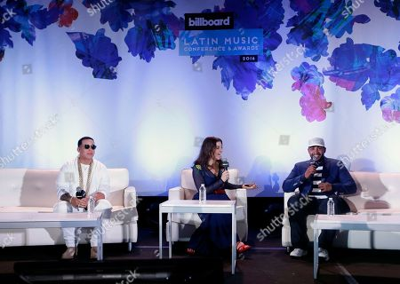 Leila Coba, Don Omar, Daddy Yankee Moderator Leila Coba, center, poses a question to Puerto Rican singer, songwriter and actor Don Omar, right, as Daddy Yankee, left, looks, in Miami Beach, Fla. The Billboard Latin Music Awards ceremony will be held next Thursday night