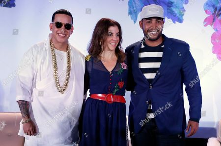 Daddy Yankee, Don Omar, Leila Coba Puerto Rican singers Daddy Yankee, left, and Don Omar, right, pose with Moderator Leila Coba, center, for photographers at the Billboard Latin Music Conference, in Miami Beach, Fla. The Billboard Latin Music Awards ceremony will be held next Thursday night. The Billboard Latin Music includes entrants from the United States, Latin America, and Spain, and performers from other countries are eligible as long as the artist performs Latin music