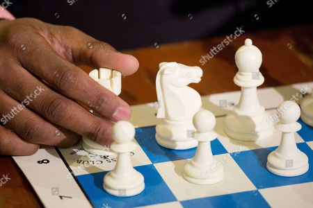 Stock Picture of Maurice Ashley Chess grandmaster Maurice Ashley has his hand on a castle during an interview at Chess Forum in New York. The Brooklyn resident has been inducted to the World Chess Hall of Fame in St. Louis