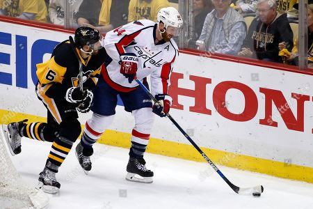 Trevor Daley, Brooks Orpik Washington Capitals' Brooks Orpik (44) clears the puck before being checked by Pittsburgh Penguins' Trevor Daley (6) during the first period of Game 6 in an NHL hockey Stanley Cup Eastern Conference semifinals in Pittsburgh