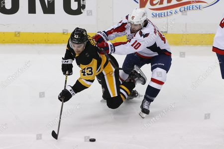 Conor Sheary, Mike Richards Pittsburgh Penguins' Conor Sheary (43) is checked to the ice by Washington Capitals' Mike Richards (10) during the third period of Game 4 in an NHL hockey Stanley Cup Eastern Conference semifinals in Pittsburgh
