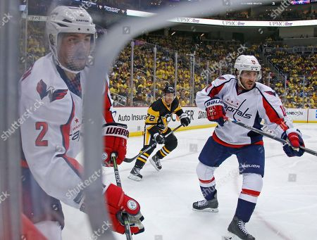 Patric Hornqvist, Matt Niskanen, Mike Richards Pittsburgh Penguins right wing Patric Hornqvist (72) is framed by Washington Capitals Matt Niskanen (2) and Mike Richards (10) during the second period of Game 4 in an NHL hockey Stanley Cup Eastern Conference semifinals in Pittsburgh