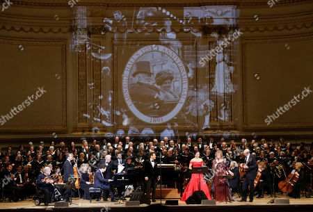 Stock Image of From left, Itzhak Perlman, Yo-Yo Ma, Lang Lang, Emanuel Ax, Michael Feinstein, Isabel Leonard, Renee Fleming and James Taylor perform during Carnegie Hall's 125th Anniversary Concert, in, New York. The Oratorio Society of New York sang along as the Orchestra of St. Lukes played conducted by Pablo Heras-Casado