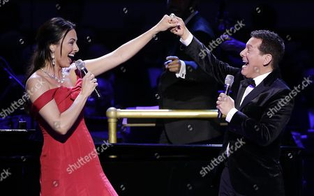 Isabel Leonard, left, sings with Michael Feinstein during Carnegie Hall's 125th Anniversary Concert, in, New York