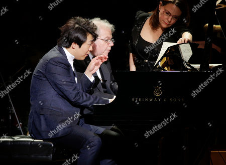 Pianists Lang Lang, left, and Emanuel Ax perform together during Carnegie Hall's 125th Anniversary Concert, in, New York