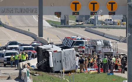 Emergency responders works the scene of a bus crash on the George Bush Turnpike, in Irving, Texas. A Dallas County jury, awarded damages to relatives of two passengers who died following the casino tour bus crash near Dallas. The survivors will share a multi-million dollar judgment against the Choctaw Nation of Oklahoma